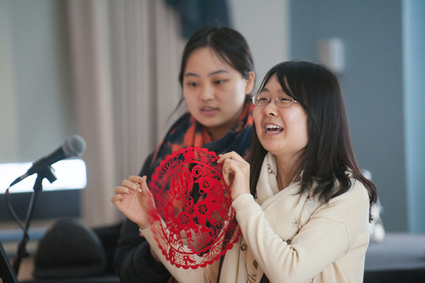 Student holding up lace design